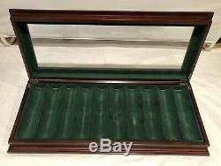 Bombay & Co. Poker chip set in mahogany case withglass top, new selaed chips