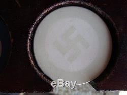 Poker chip set with Swastika and bull dog chips